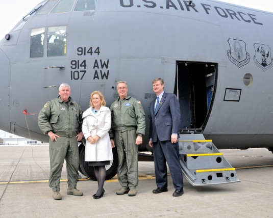 Officers posing in front of C-130 with Senator Kirsten Gillibrand