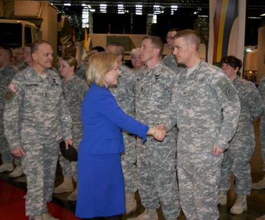 Senator Kirsten Gillibrand greets New York Army National Guard Warrant Officer Candidate Joshua Udell in Troy, N.Y.