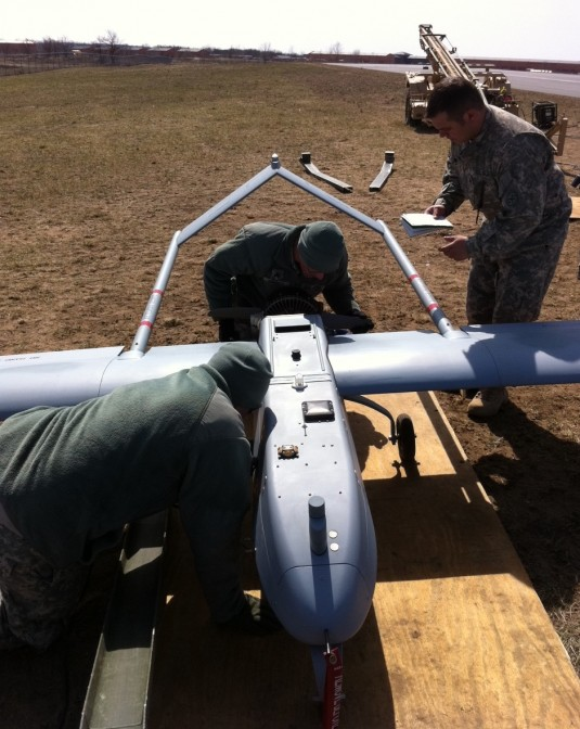 Soldiers of Detachment 1, Company B, 27th Brigade Special Troops Battalion perform preflight checks on the RQ-7 Shadow.