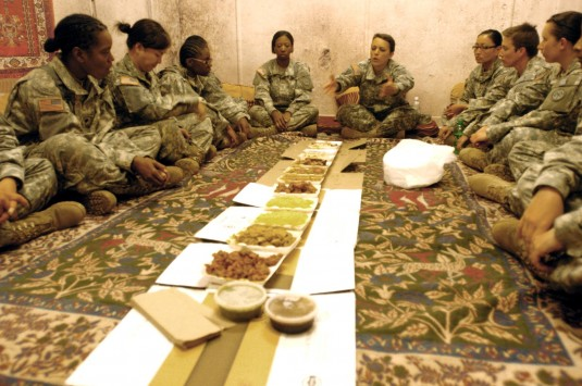 Female Soldiers learning to dine Afghan style
