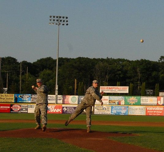 Guard father and son throwing opening pitch