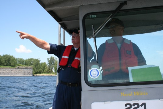 New York Naval Militia Petty Officers Jeff Alexander, left, and Robert Hill maneuver Patrol Boat PB 221 near the historic site of Fort Montgomery on Lake Champlain July 16.