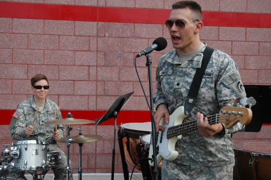 Soldiers playing drums and guitar.