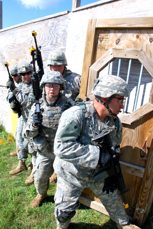 of the 27th Infantry Brigade Combat Team prepare to enter and clear a house during premobilization training