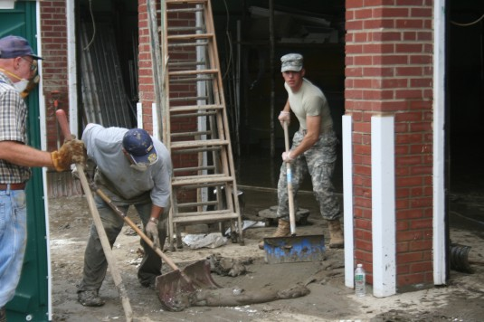 A Soldier from the New York Army National Guard's 206th Military Police Company, based in Latham, N.Y. clears debris at the Middleburgh Central School Sep. 2.
