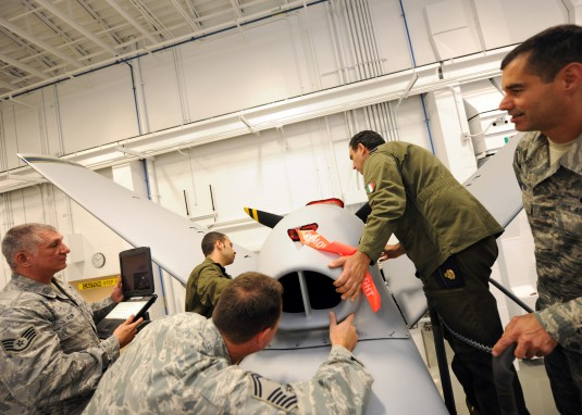 Airmen working on MQ-9