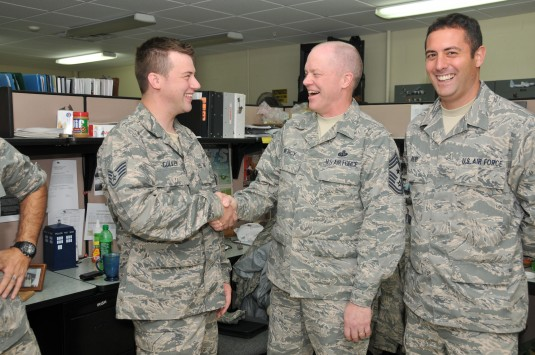 Air Force NCO's shaking hands
