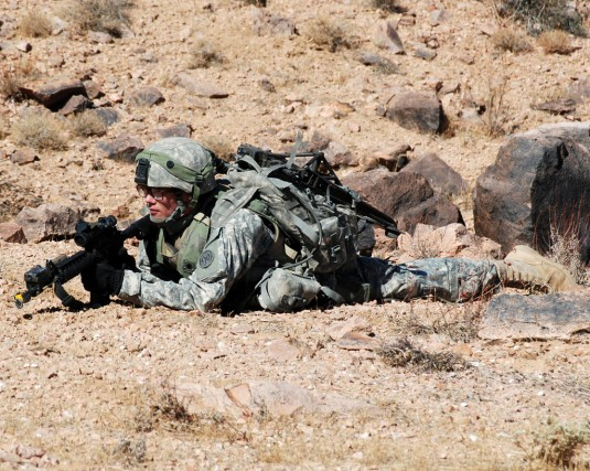 Soldier takes cover at NTC