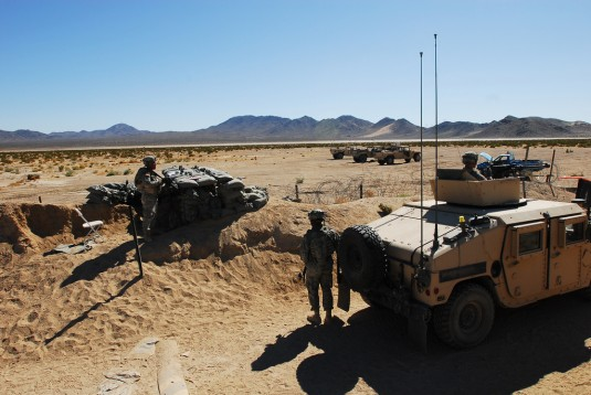Soldiers at a desert checkpoint