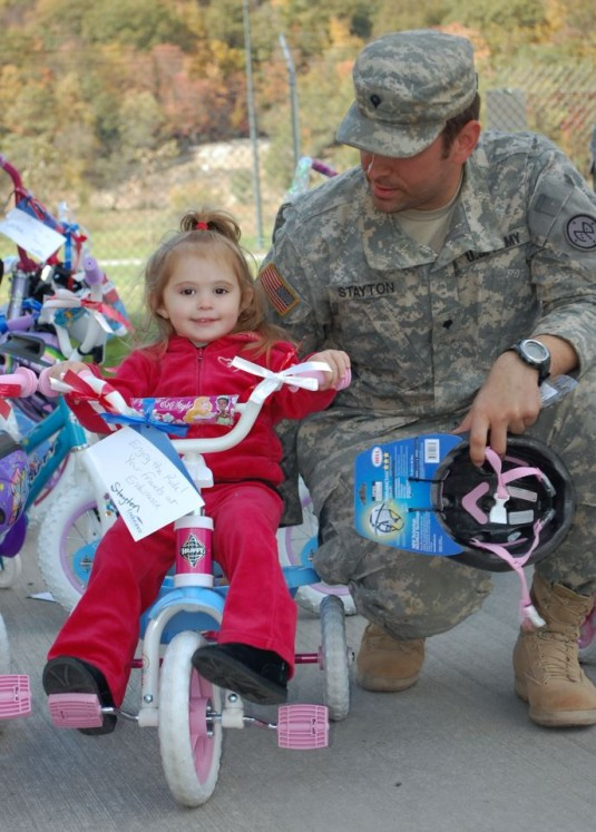 Soldier and daughter with donated bike.