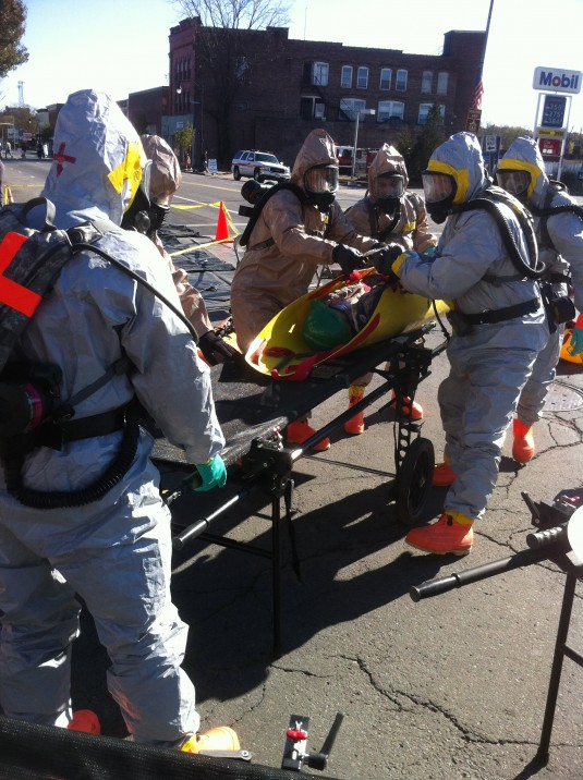 New York National Guard Soldiers from the Chemical, Biological, Radiological, Nuclear or High Explosive (CBRNE) Enhanced Response Force Package bring a simulated casualty to the decontamination site here during a domestic operation training exercise Nov.