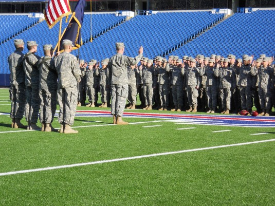 One hundred New York Army National Guardsmen reaffirm their oath of service and later participated in a flag unfurling at the start of an Buffalo Bills National Football League game