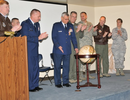 MG Kwiatkowski receiving globe as a retirement gift.