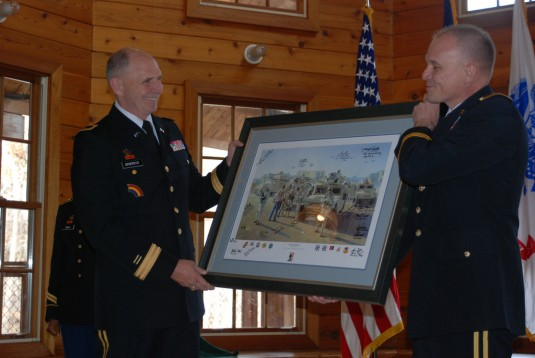 Maj. Gen. Steven Wickstrom, commander of the 42nd Infantry Division, presents a retirement gift to Brig Gen. Paul Genereux during Genereux's retirement ceremony at West Point on Saturday, Jan. 14