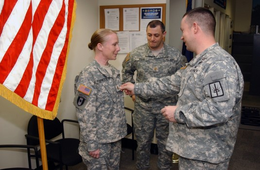 New York Army National Guard Lt. Tracy Pauquette receives her gold bar as a newly commissioned second lieutenant from Capt. John Klimes