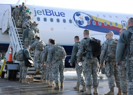 Soldiers boarding aircraft