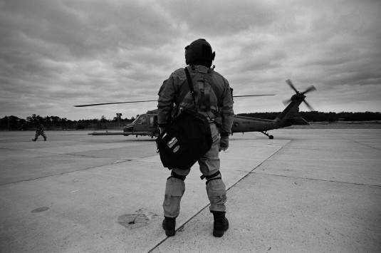 National Guard Airman waiting to board helicopter
