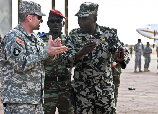 New York Army National Guard Command Sgt. Maj. Justin Lenz, a Bellmore, N.Y. native with the 369th Sustainment Brigade  and Malian army Lt. Abdrahamane Kone, a native from Mopti, Mali acting as Security Operations for Malian Defense Force, have a discussi