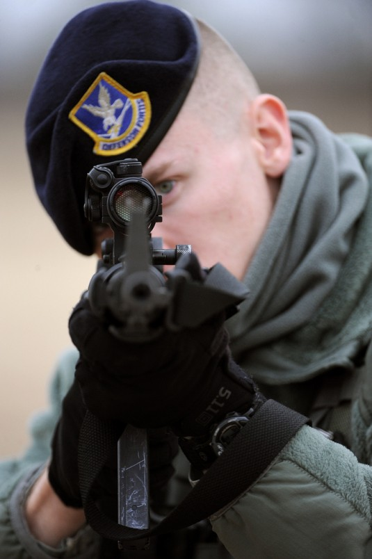 Airman First Class Luke McNamara, a security forces member, sights an empty rifle during training on February 16th, 2012.