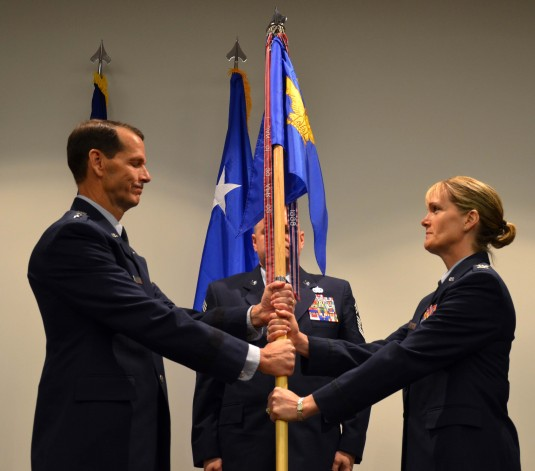 Col. Dawne L. Deskins receives the Eastern Air Defense Sector guidon Friday morning from Lt. Gen. Stanley E. Clarke, Commander, Continental U.S. North American Aerospace Defense Command Region (CONR)/1st Air Force (Air Forces Northern).