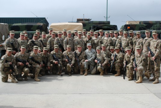 Members of the New York Army National Guard Strategic Transition Team pose with Major General Steven Wickstrom, the commander of the 42nd Infantry Division, at the Army National Guard Readiness Center here prior to departing for Afghanistan on Wednesday,