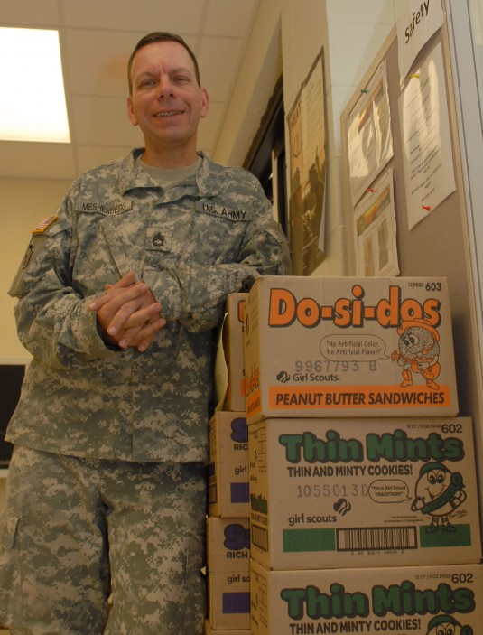 Sgt. 1st Class Walter Meshenberg poses with some of the 3,600 boxes of cookies the Girl Scout Council of Suffolk County, N.Y. recently delivered to 27th Infantry Brigade Combat Team Soldiers