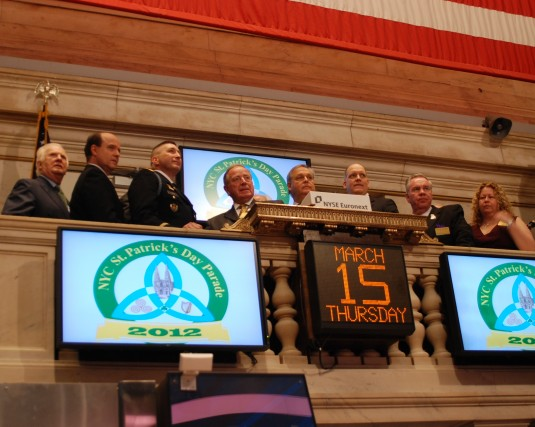New York Army National Guard Lt. Col. James Gonyo, the commander of the 1st Battalion 69th Infantry, joins members of the New York City St. Patrick's Day Parade Committee in ringing the closing bell at the New York Stock Exchange on Thursday, March