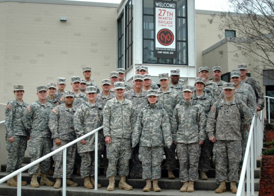 New York Army National Guard Soldiers of the Base Defense Operations Cell (BDOC) pose outside the Mississippi Armed Forces Museum here.