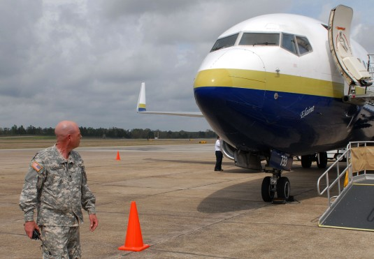 Spc. Matthew Shearer, of Voorheesville, N.Y., inspects the exterior of an airliner following a flight. Shearer belongs to C Company, 27th Brigade Special Troops Battalion, which used the airport to learn airport security operations March 12 to 14.