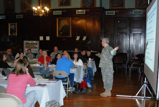 New York City and Long Island New York Army National Guard Family Readiness Program volunteers listen to Lt. Col. Gary Hoffman, an Army National Guard lawyer,explain what Family Readiness Groups can and cannot do legally during training at the Lexington A
