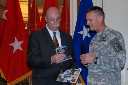 Jerome Hauer,Commissioner of the New York State Department of Homeland Security and Emergency Services receives a token of thanks from Major General Patrick Murphy, the Adjutant General of New York, following a talk to the leaders of the New York Army and