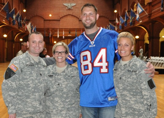 Buffalo Bills tight end Scott Chandler poses with New York Army National Guard Soldiers during a Freedom Salute event for the 105th Military Police Company held April 22 at the Connecticut Avenue Armory here