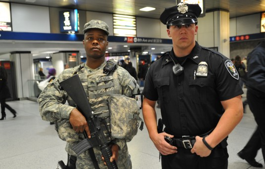 New York Army National Guard Sgt. Leopoldo DeSilva (left) pulls security duty in Pennsylvania Station on Wednesday, May 2 with an Amtrack Police Officer.