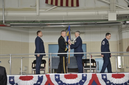 Major General Patrick Murphy, the Adjutant General of New York, passes the unit flag over to Colonel Shawn Clouthier, the incoming commander of the 109th Airlift Wing on Saturday May 5th 2012 at Stratton Air National Guard base, Scotia New York.