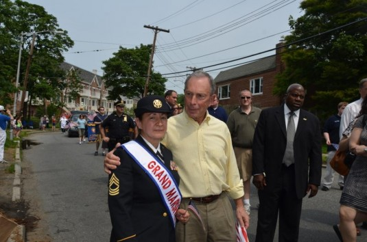 New York Army National Guard Master Sgt. Jessica Huff poses with New York City Mayor Michael Bloomberg during the College Point Memorial Day Parade on Sunday May. 27.