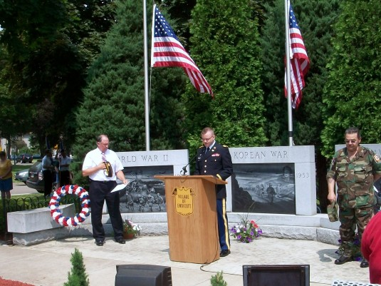 New York Army National Guard Chaplain Candidate ( 1st Lt.) Timothy Miller, a member of the 204th Engineer Battalion, delivers the invocation at the Memorial Day Ceremony in Endicott on May 28.