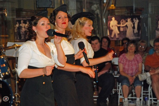 Singers dressed up as a 1940s girl group perform for visitors at the New York State Military Museum on May 19.