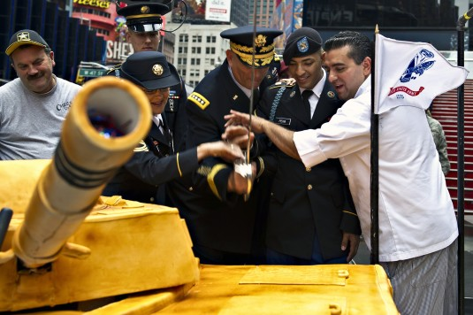 New York Army National Guard Private Cheyanne Jose Pena joins General Raymond Odierno, the Chief of Staff of the Army in cutting the Army Birthday Cake during a ceremony in Times Square on Thursday, June 14, the 237th Birthday of the United States Army.