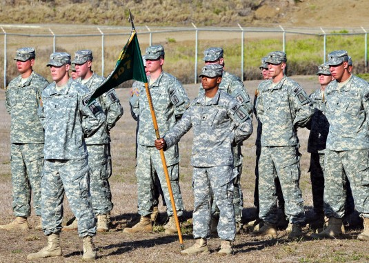 New York Army National Guard Citizen-Soldiers of the 107th Military Police Company stand in formation during a Transfer of Authority ceremony on June 12 as the unit turned over the security mission it had been conducting to 755th MP Co., Puerto Rican Army