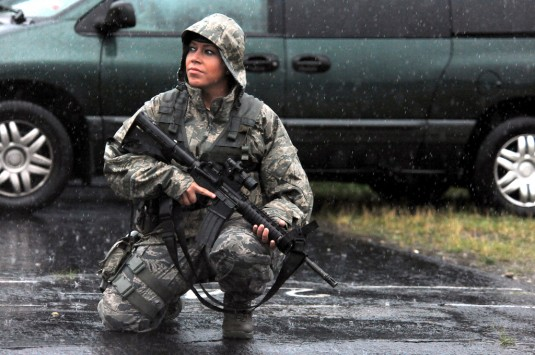 WESTHAMPTON BEACH, NY - Senior Airman Tara Langella works the front gate at FS Gabreski ANG during a major thunderstorm on June 25, 2012.