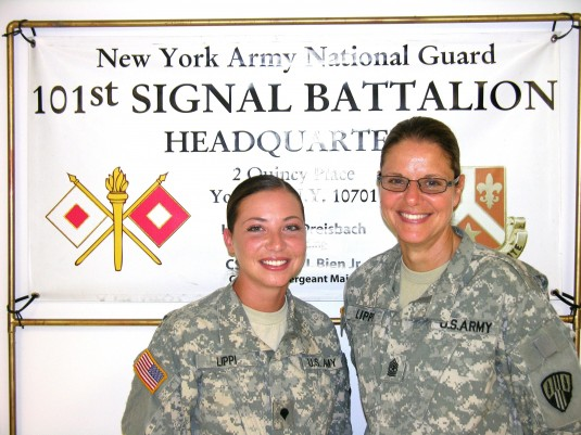 CAMP SMITH-- New York Army National Guard Specialist Alexandra Lippi (left) will deploy to Afghanistan along with her mother Sgt. Major Gina Lippi (right) when the 101st Signal Battalion mobilizes in August.