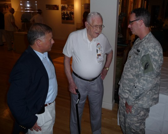 New York Army National Guard Col. Phil Pugliese, left, Chief of Staff of the 42nd Infantry Division Headquarters, speaks with WWII veteran of the famed