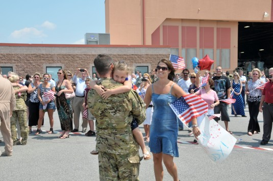 New York Air National Guard Tech.Sgt Brandon Guthinger, a flight engineer with the 109th Airlift Wing, gets a warm welcome from his wife Misty and daughter Brianna as he returns from South East Asia.