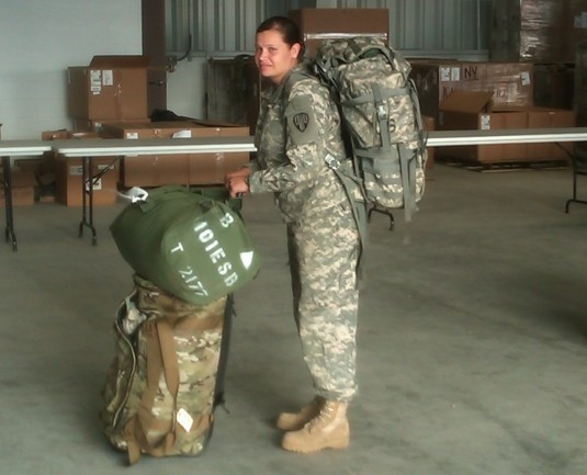 New York Army National Guard Sgt. Krystal Tesoriero, a member of the 101st Expeditionary Signal Brigade,  draws deployment gear from the Central Issue Facilty as premobilization training begins here on Saturday, July 15.