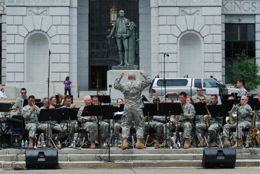 Chief Warrant Officer Mark Kimes leads musicians of the 42nd Infantry Division Band percussion section perform at West Capitol Park
