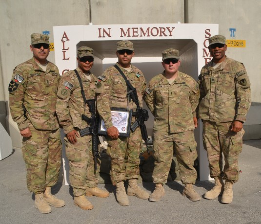 Command Sgt. Maj. Charlie G. Chavez,(left) 401st Army Field Support Brigade command sergeant major and Col. Michel M. Russell Sr.,(right) 401st AFSB commander flank New York Army National Guard Soldiers Spc. David P. Clark, Spc. Justin C. Ruiz and 1st Lt.