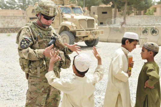 Col. Alden Saddlemire greets Afghan children near the distric center of Spin Boldak