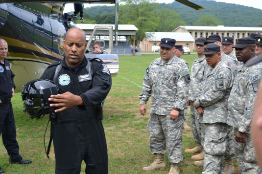 New York Guard Search and Rescue volunteers receive emergency helicopter evacuation procedures from NY State Police Technical Sgt. Duwayne Tinsley