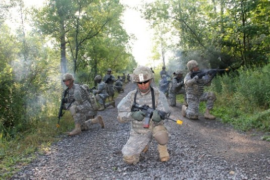New York Army National Guard Soldiers with the 101st Expeditionary Signal Battalion practice reacting to direct fire while going through obstacles during a dismounted execution training here Aug 1.