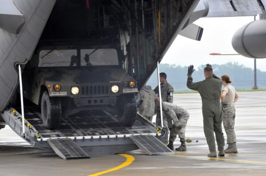 New York Army National Guard Soldiers from the  42nd Infantry Division load personnel and cargo onto a C-130 Hercules aircraft here on August 10th, 2012.